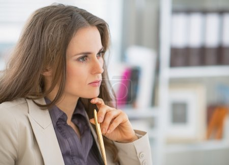 Photo for Portrait of concerned business woman sitting in office - Royalty Free Image
