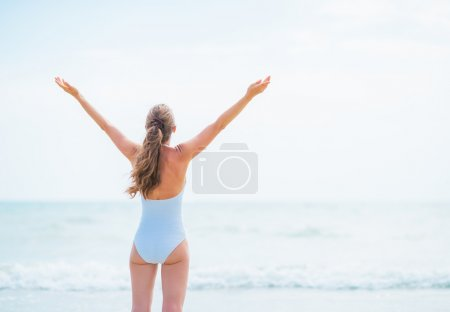 Woman rejoicing at seaside