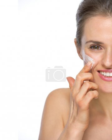 Woman applying creme