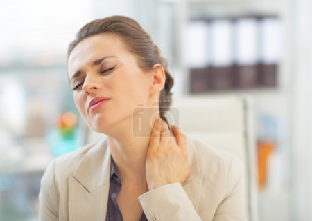 Business woman with neck ache