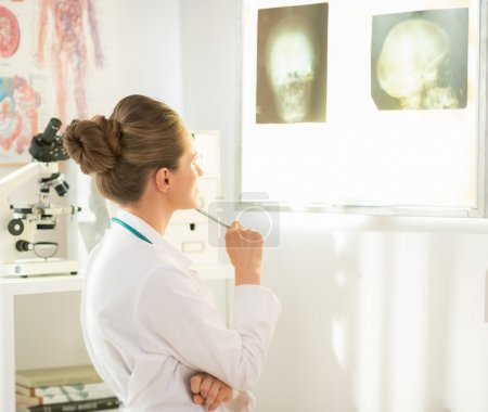 Doctor woman looking on fluorography