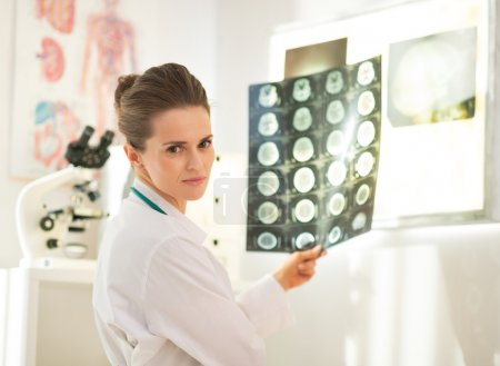 Portrait of medical doctor woman with tomography