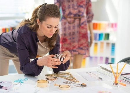 Fashion designer choosing accessories