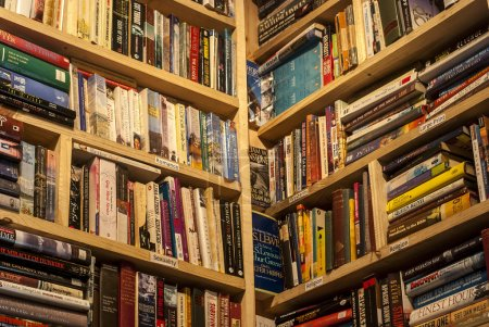 Photo for Second-hand bookstore shelves corner horizontal symmetric as background - Royalty Free Image