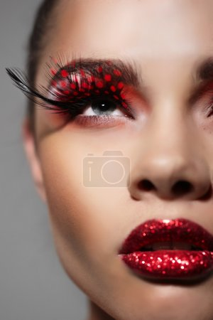 Woman face with Creative Fashion Art make up