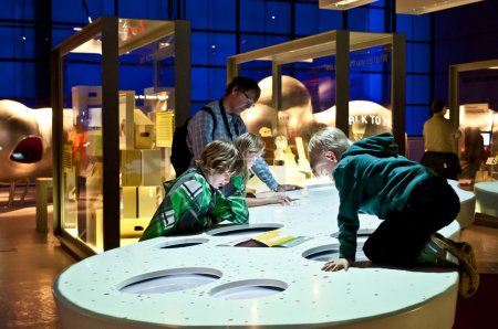 Photo for Inside the Science Museum, London, UK. Children discover new technology. - Royalty Free Image