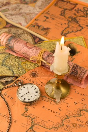 Antiquarian pocket watch and ancient world maps