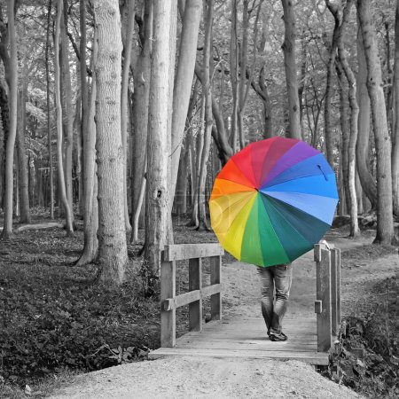 Photo for Surreal background - woman with colorful umbrella in the woods - Royalty Free Image