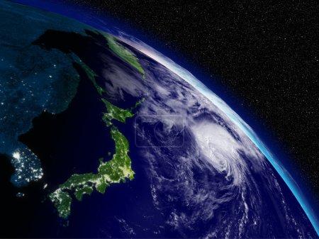 Photo pour Tôt le matin sur les îles japonaises en vue de l'espace. surface de la planète très détaillées avec les nuages et les lumières de la ville. éléments de cette image fournie par la nasa. - image libre de droit