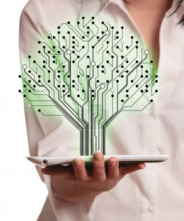 Photo for Abstract circuit board pattern in the shape of the tree in hand women. - Royalty Free Image