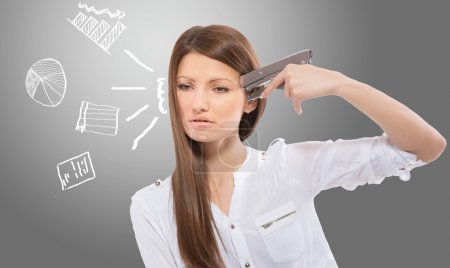 Desperate office lady with the drawn charts, gray background