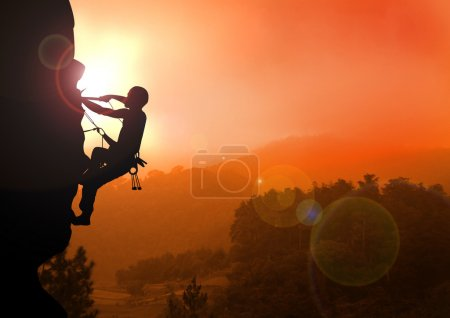 Photo for Stock illustration of a man doing Mountain Climbing on Sunrise - Royalty Free Image