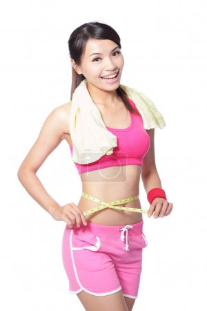 Woman smile measuring waist after sport