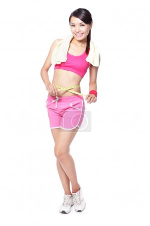 Woman measuring shape waist in full length