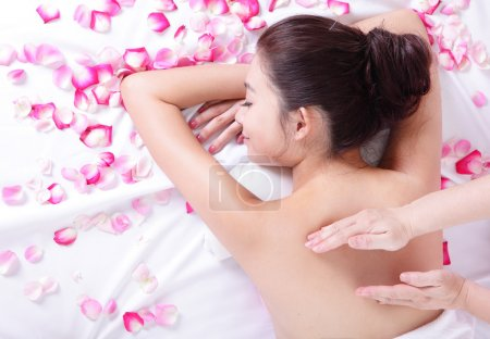young woman getting massage and spa