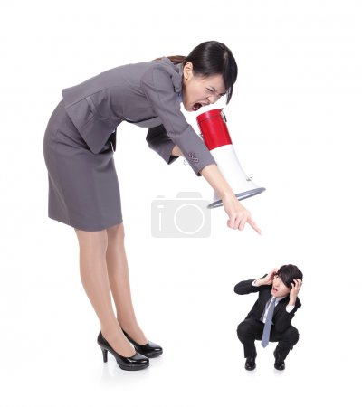 Big angry boss (business woman) with megaphone yel...