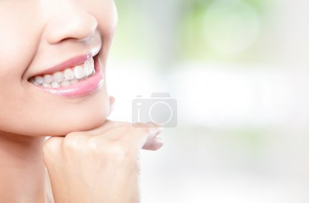 Photo for Beautiful young woman teeth close up with copy space on the right side. Isolated over green background, asian beauty model - Royalty Free Image