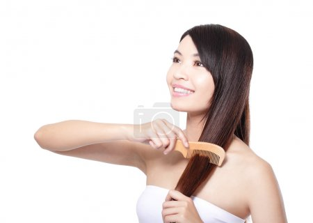 young woman comb wonderful hair