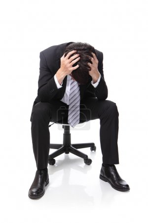 Frustrated business man sitting