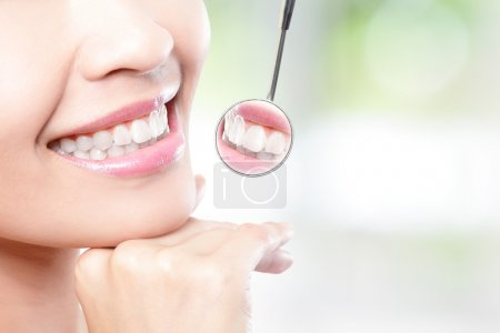 Healthy woman teeth and dentist mouth mirror