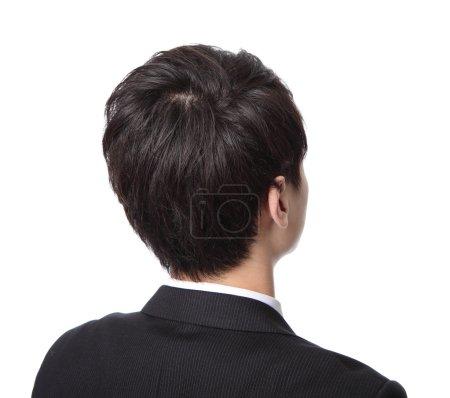 Photo pour Homme d'affaires de l'arrière - en regardant quelque chose isolé sur fond blanc, asiatique - image libre de droit