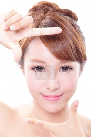 Photo for Beautiful Woman face and she making frame with hands, concept for skin care , asian woman - Royalty Free Image
