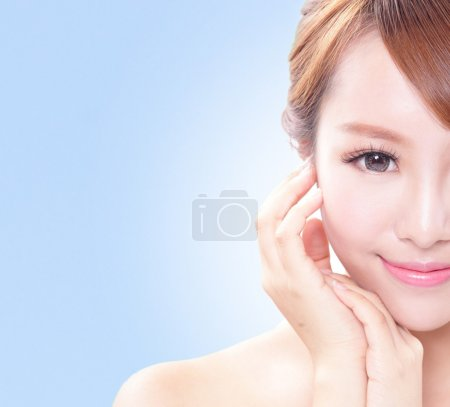 Photo for Portrait of the woman with beauty face and perfect skin isolated on blue background, asian beauty - Royalty Free Image