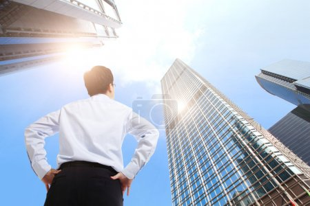 Successful business man outdoors Next to Office Building