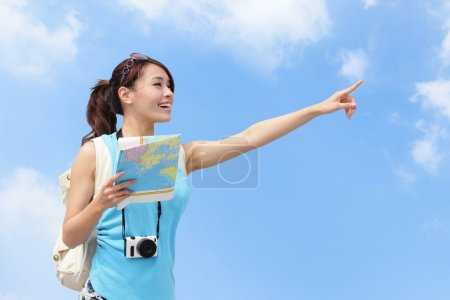 Happy women traveler pointing at something