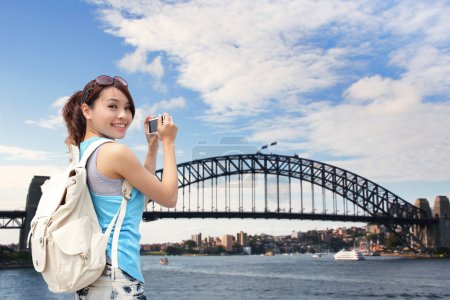 Photo for Happy woman traveler taking photo by camera in Australia - Royalty Free Image