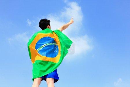 Man holding a brazil flag