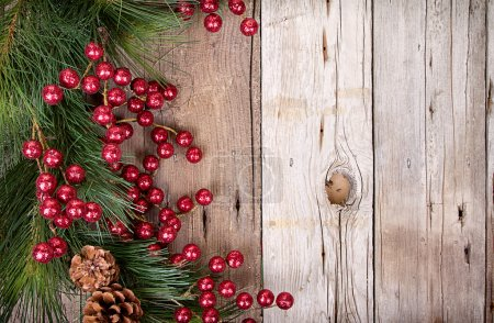 Photo for Pine branches with Christmas berries on wooden panels - Royalty Free Image