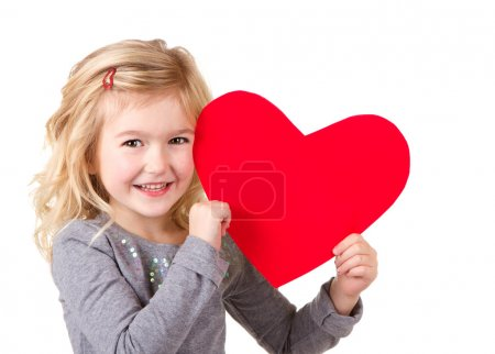 Photo for Little girl holding red heart, close-up isolated on white - Royalty Free Image