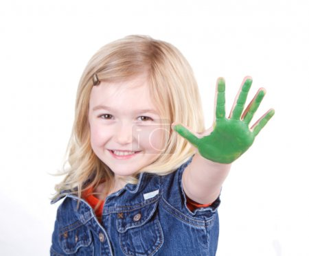 A child with green paint on her hand