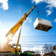 Mobile crane operating by lifting and moving an he...