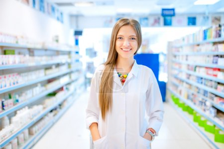 pharmacist chemist woman standing in pharmacy drugstore