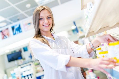 Sexy blonde pharmacist selling antibiotics and prescription drugs