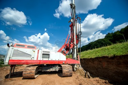 Industrial machinery for drilling holes in the ground. Construction site with drilling rig