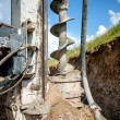 Close up of auger, industrial drilling rig making ...