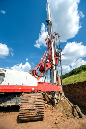 Industrial drilling rig at construction site making holes and drilling