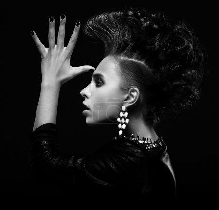 Strange stylish punk woman saluting and gesturing