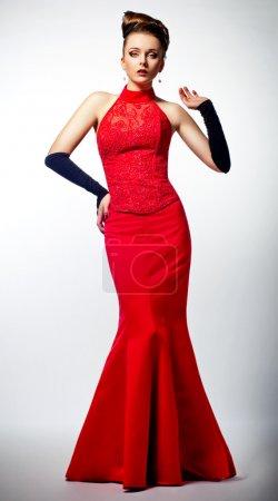 Slim beauty fiancee - luxurious red wedding dress. Beauty hairdo