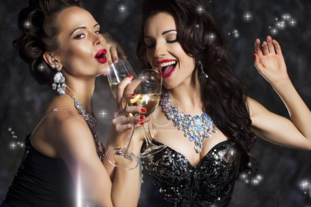 Photo for Happy Laughing Women Drinking Champagne, Singing Xmas Song - Royalty Free Image
