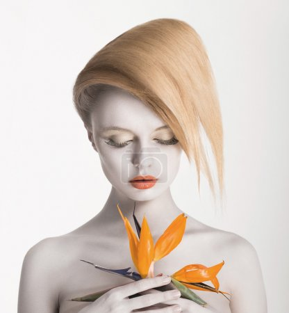 Bodyart. Fancy Daydreaming Woman with Exotic Flower. Allure