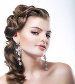 Delight. Elegant Posh Woman Bride with Diamond Earrings. Platinum Jewelry