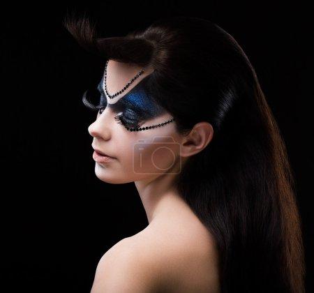 Blue Eye Shadows. Mascara. Woman with Modern Bright Colorful Makeup. Face Art