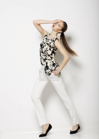 Vogue. Modern Female wearing Trendy Pants. Fashion Collection