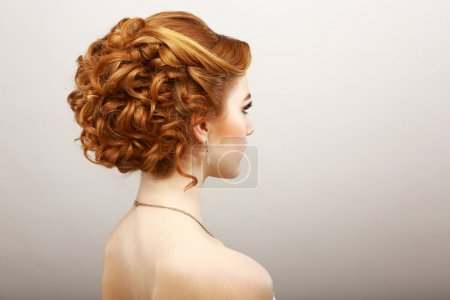 Styling. Rear View of Frizzy Red Hair Woman. Haircare Spa Salon Concept