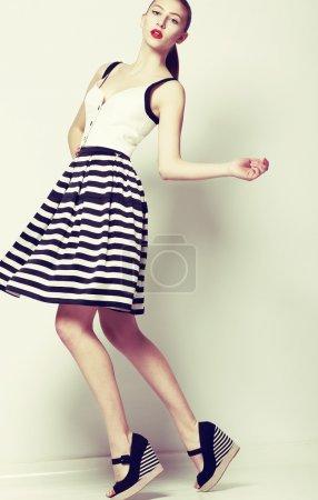 Photo for Feminine. 60s Fashion Style. Pretty Stylish Woman in Retro Short Dress - Royalty Free Image