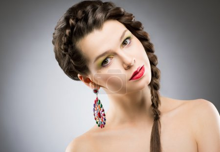 Portrait of Bright Brunette with Jewellery - Round Colorful Earring. Shining Bijouterie